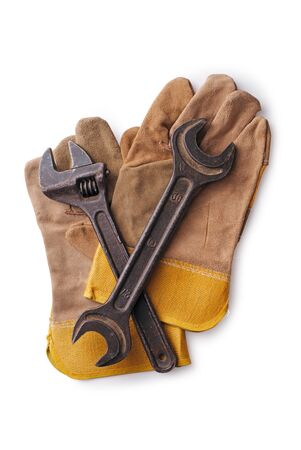 Closeup on two wrenches on protective gloves on a white background photo