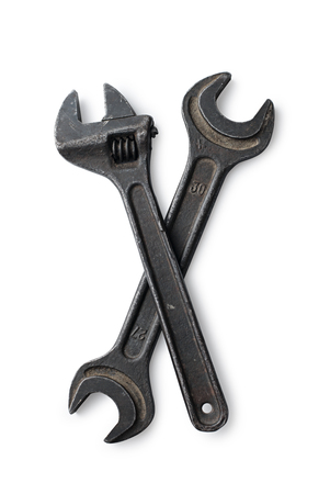 housebuilding: Closeup adjustable wrench and wrench on a white background