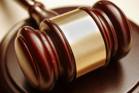 verdicts: Gavel close up. Conceptual image of law and justice.