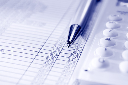 accountancy: calculator, pen and business papers on the desk in the office Stock Photo