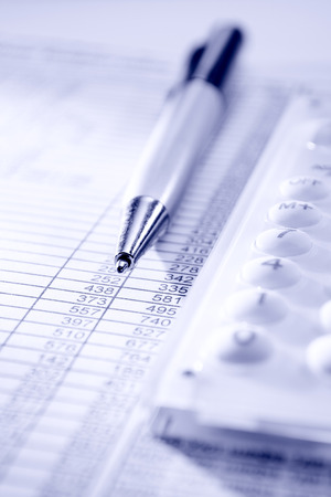 metrics: calculator, pen and business papers on the desk in the office Stock Photo