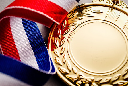 Gold medal with blank face for text, concept for winning or success Foto de archivo