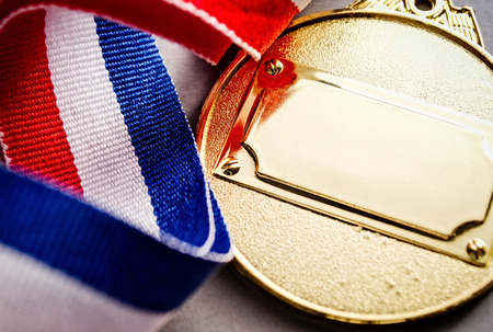 medalist: Gold medal with blank face for text, concept for winning or success Stock Photo