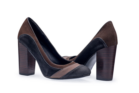girl soles: A pair of womens shoes black stilettos with a decorative belt on a white background Stock Photo