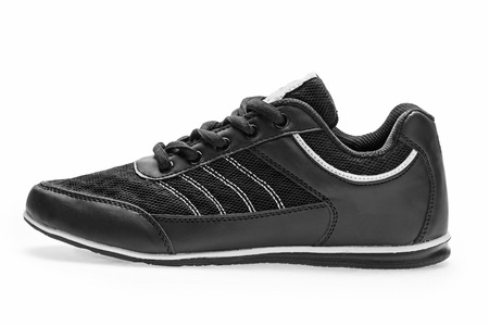 shoelace: One black sports sneaker with shoelace on a white background