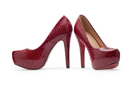 fetishism: Red high heels, symbolic photo for fashion and elegance on a white background Stock Photo