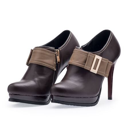lady's: A pair of womens shoes brown stilettos with metal buckle on a white background