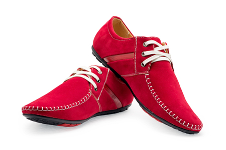 Pair leather red color male moccasins with shoelaces on a white background