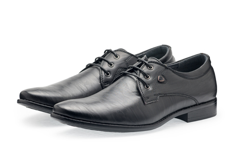 white men: A pair of classical black leather shoes for men, with shoelaces on a white background