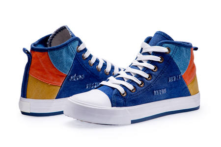 trainers: Pair of high top color denim gymshoes on a white background