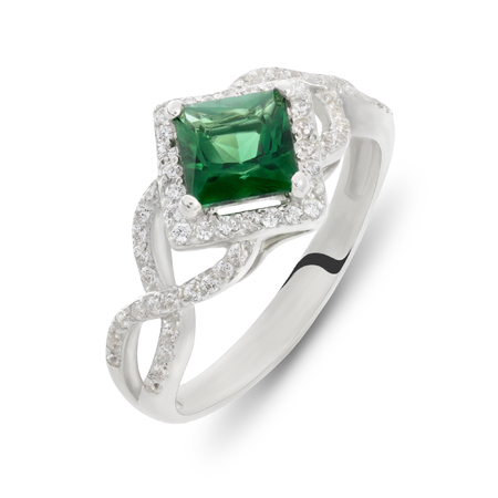 green tourmaline: Close up on elegant green emerald ruby and diamond studs interlaced over silver ring over white background