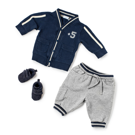 velcro: Child size jersey jacket, sweat pants with blue lines and pair of little matching velcro shoes over white background