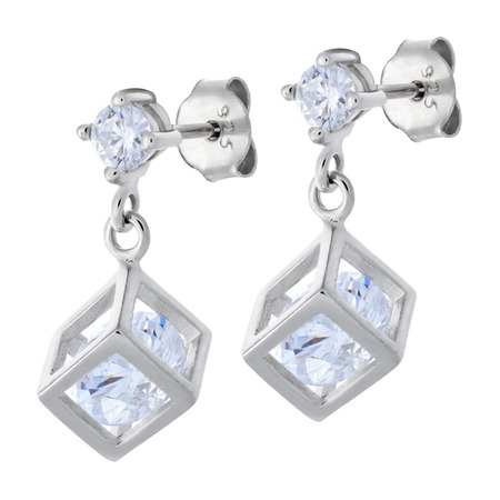 cloesup: Cloes-up on pair silver pendants earrings with diamonds in the shape of a cube over white background Stock Photo