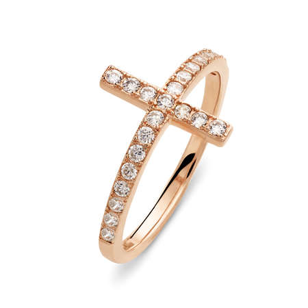 cloesup: Cloes-up on single gold ring with diamonds of the form of cross over white background with slight set down shadow