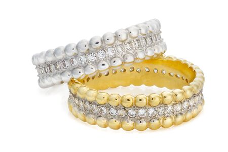 karat: Two bracelets made of a gold and a silver with diamonds around the entire circumference on a white background Stock Photo