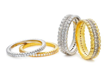 karat: Four bracelets made of a gold and a silver with diamonds around the entire circumference on a white background Stock Photo