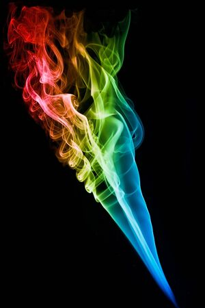 sexual abstract: Colored smoke with beautiful swirls on black background
