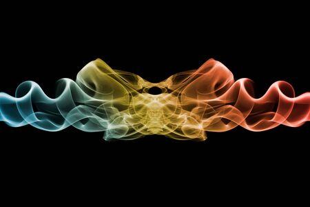 Colored smoke with beautiful swirls on black background