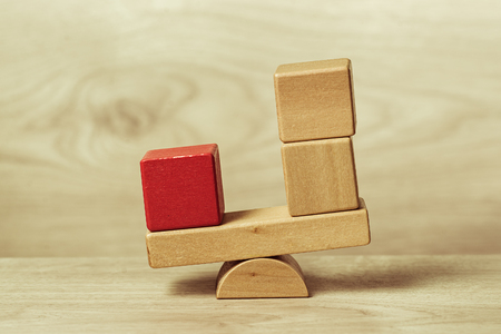 wooden toy: The concept of balance shown wooden toy blocks Stock Photo