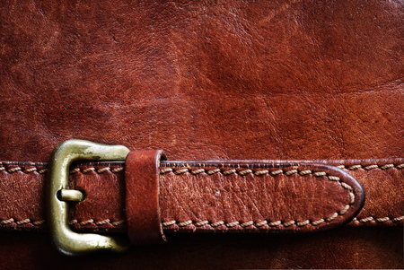 Leather background with excellent texture for design  and a leather belt with a buckle Stock Photo