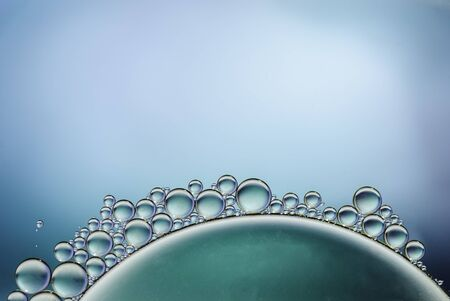 oil drops on a water surface abstract background blue