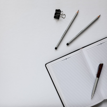 Top view of an office desk with stationery items