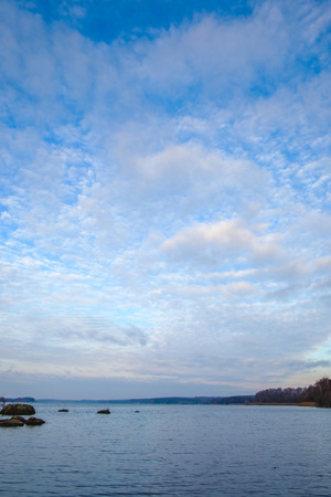 Beautiful clouds over the river in the morning after sunrise Stock Photo