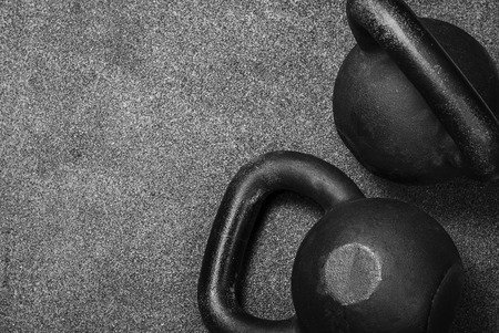 two heavy kettlebell black on gray background