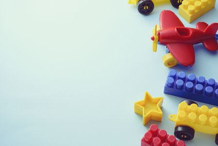 Side border of colorful kids toys on white with copy space Stock Photo