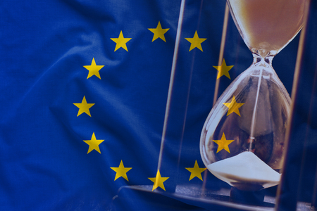 European Union flag with the hourglass in background concept, as a political event time running out theme