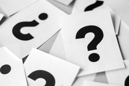 Paper cards with a big question mark. The concept of finding the answer to the question.