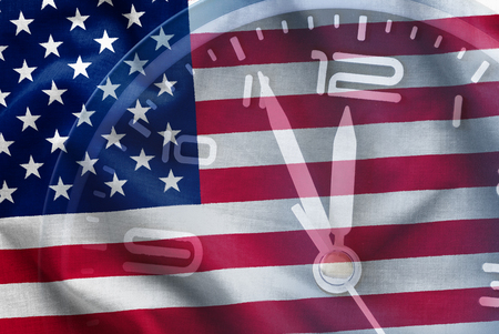 Composite of the American flag, Stars and Stripes, Old Glory, with a clock dial showing the time as five to twelve in a conceptual image