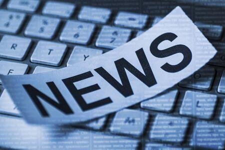 Closeup of news inscription on white sheet on background of white keyboard Banco de Imagens - 128130868