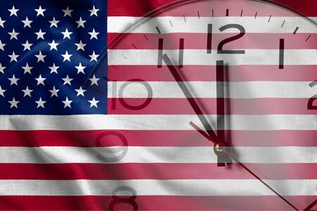 Double exposure of USA flag and clock-face showing time