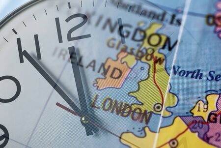 Double composure of United Kingdom on globe and clock-face in concept of Brexit Reklamní fotografie