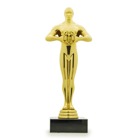 Statue Oscar award made of gold and in form of male on white background