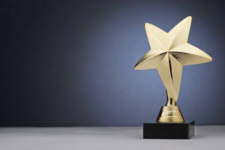 Golden shiny trophy for victory in competition in star shape
