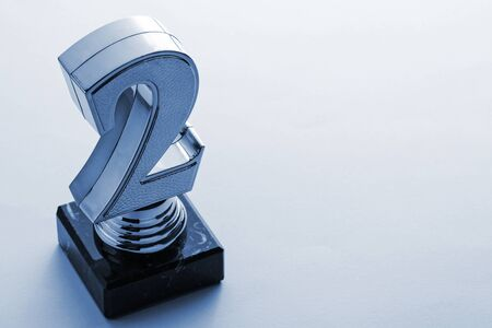 Second place runner up silver award trophy for a competition or championship event viewed high angle on grey with copy space Stock Photo
