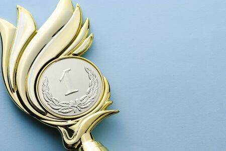 Gold medallion winners trophy with laurel wreath for the winner of a competition of championship event over grey with copy space Reklamní fotografie