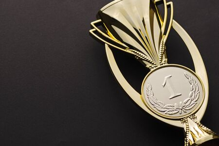 Gold medallion award for a first place or win in a championship event or competition over black with copy space