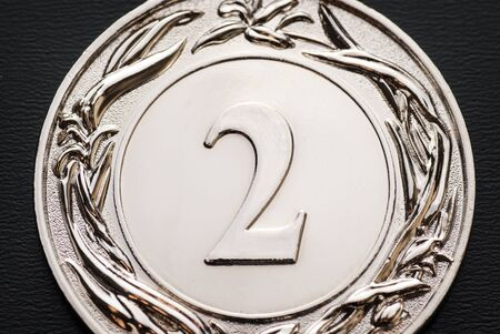 Silver winners medal for the 2nd place runner-up of a competition or race in a close up cropped view Reklamní fotografie