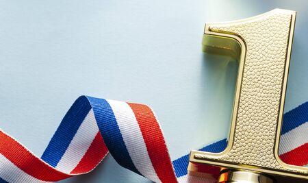 Number one textured gold winners trophy for a championship, race, competition or event with twirled ribbon on a white background with copy space Stok Fotoğraf