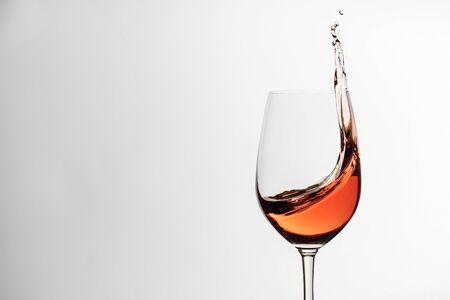 Pink or rose wine in an elegant wineglass in a viticulture concept