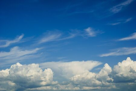 White cumulus clouds against blue sky, viewed from low angle. Cloudscape without horizon visible Stok Fotoğraf