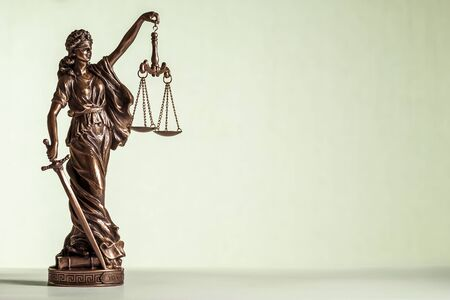 Bronze statue of Justice with sword and scales