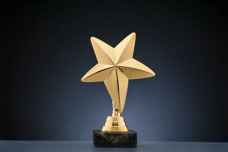 Gold star sporting trophy for a championship Stock Photo