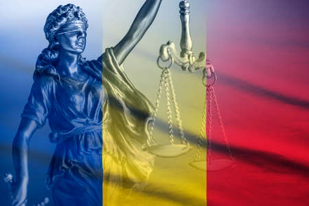 Romanian national flag with figure of Justice Stock Photo