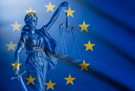 Statue of Justice over a European Union Flag Stock Photo