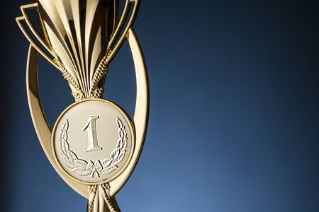 Gold championship winners trophy or cup with copy space
