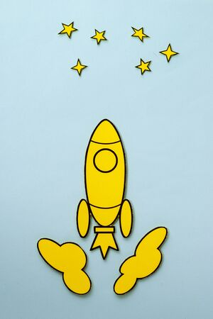 Yellow cartoon rocket flying to the stars Stok Fotoğraf